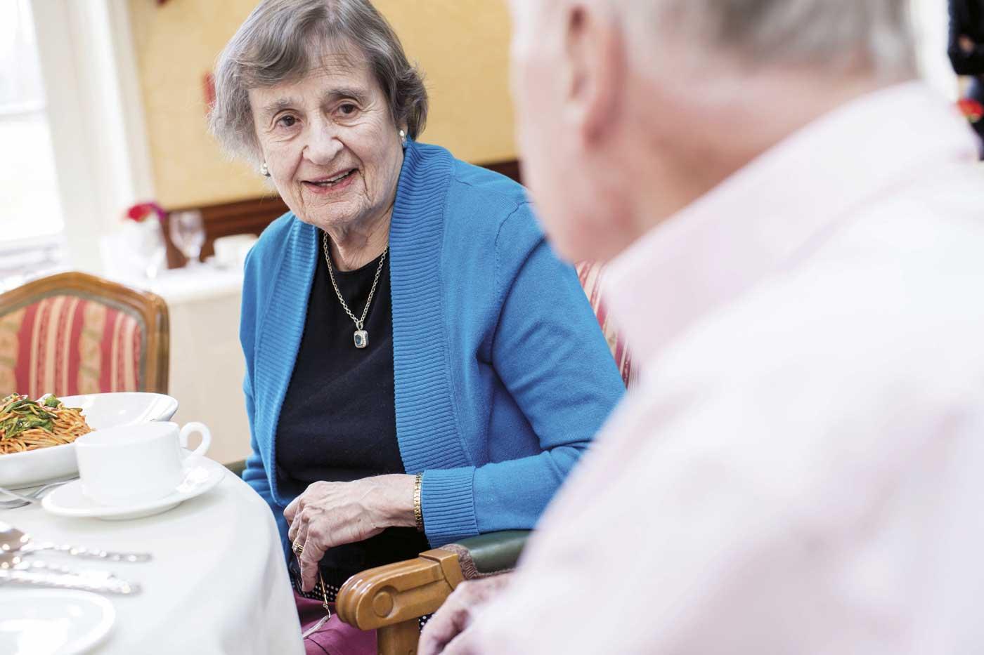 grand oaks senior living resident at dinner