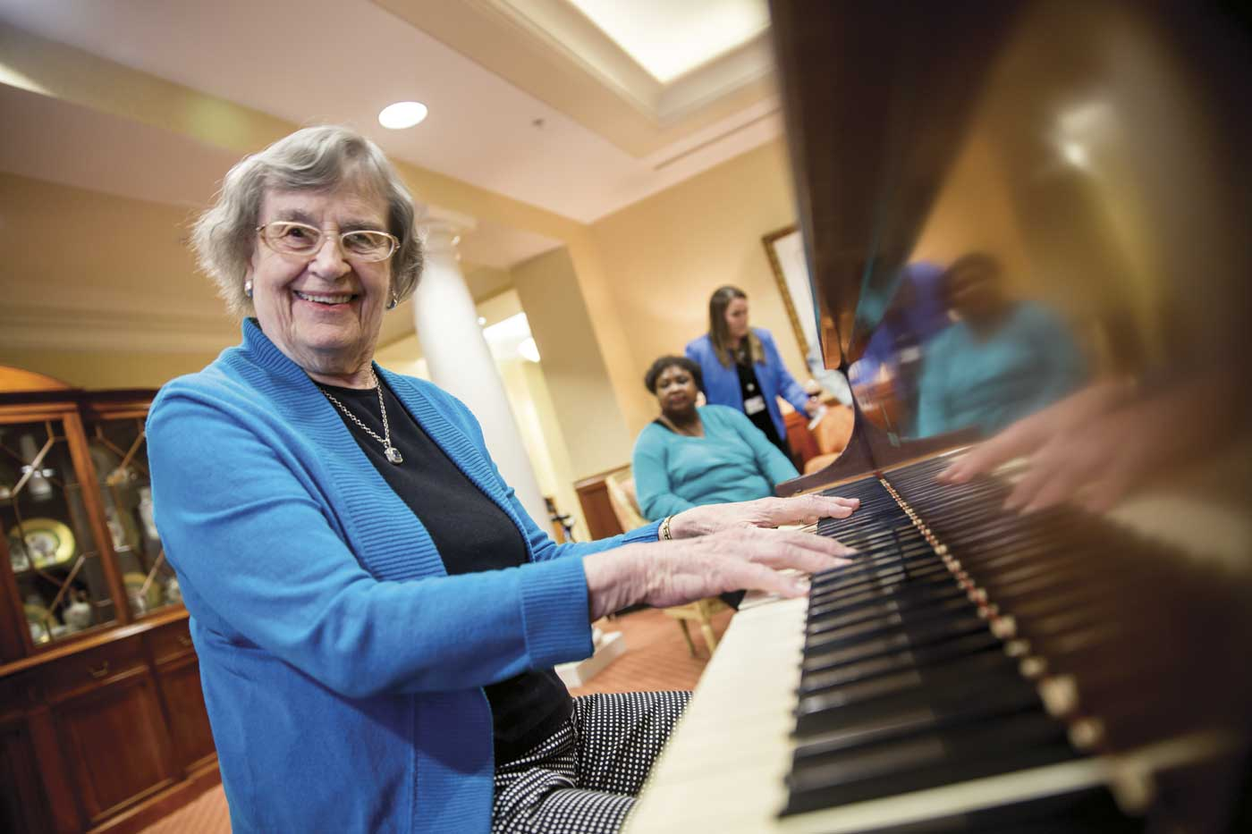 grand oaks senior living resident with piano