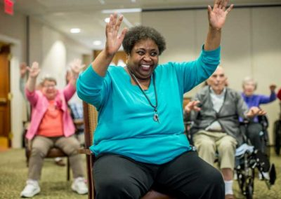 Resident participating in group exercise