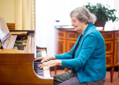 Resident playing piano