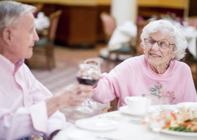 Residents toasting in dining room
