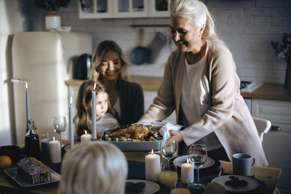 family gathering safely for Thanksgiving dinner